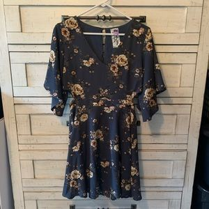 Navy blue floral dress. With the sides cut out
